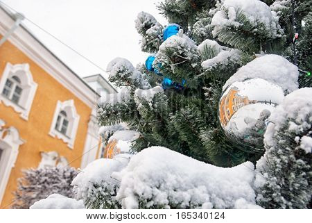 PETERHOF, SAINT - PETERSBURG, RUSSIA - JANUARY 15, 2017: Reflection of The Grand Palace in the Christmas ball on the tree. The State Museum Preserve Peterhof. The Upper garden in winter period