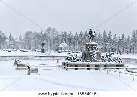 PETERHOF, SAINT - PETERSBURG, RUSSIA - JANUARY 15, 2017: Neptune Fountain and Apollo Belvedere Statue in a bad weather. The Upper Garden in winter period The State Museum Preserve Peterhof