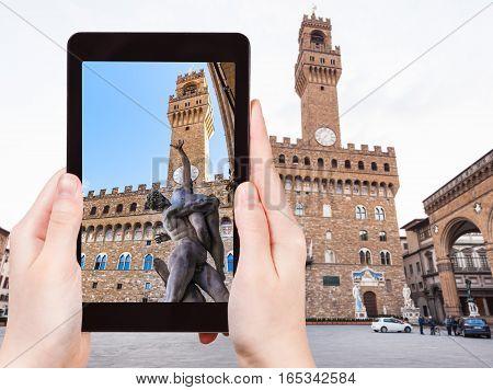 Tourist Photographs Sculpture Near Palazzo Vecchio