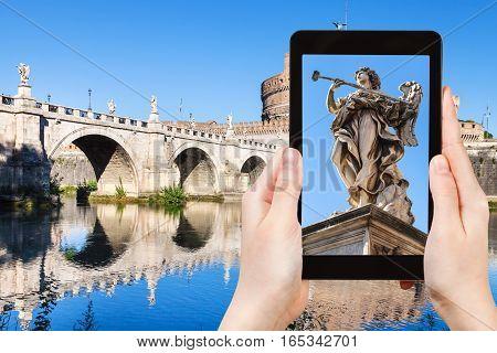 Tourist Photographs Angel Statue On Bridge In Rome