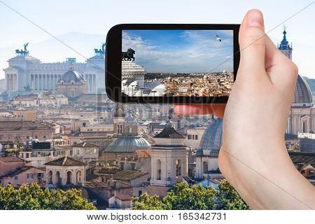 Tourist Photographs Rome Skyline On Smartphone