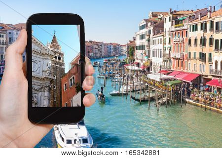 Tourist Photographs Buildings In Venice City