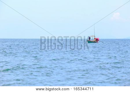 fishing boat and fisherman at sea or ocean water and blue sky background for copy space.