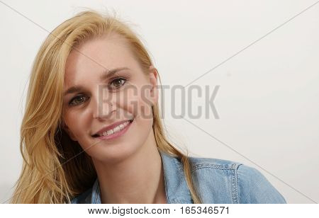 Portrait of a beautiful young blonde woman and smiling