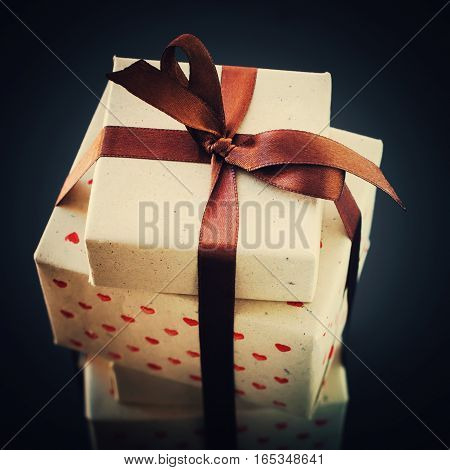 Gifts In Vintage Handmade Paper With Brown Bow