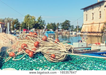 fishing net in the harbor in the background fishing boats in the lagoon