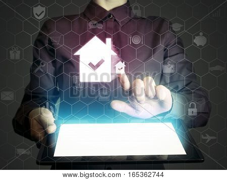 Image of a girl with tablet in her hands. She looking for a house for buying or for rent using online searching service. Real estate. Online for buying or for rent.