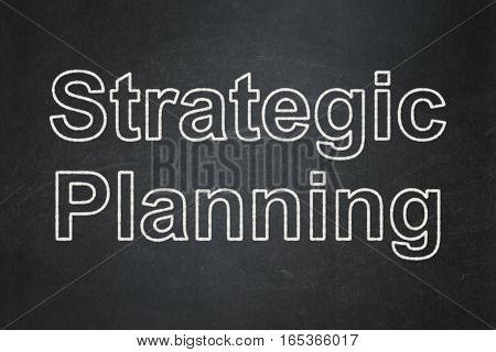 Finance concept: text Strategic Planning on Black chalkboard background