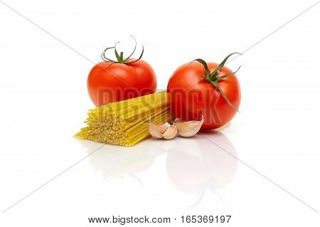 pasta tomatoes and garlic on a white background. horizontal photo.