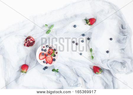 Healthy breakfast with yogurt and berries. Top view flat lay