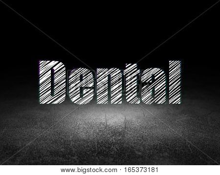 Health concept: Glowing text Dental in grunge dark room with Dirty Floor, black background