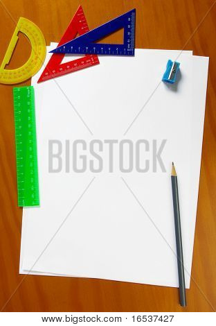 Colorful student gear and blank sheets of paper