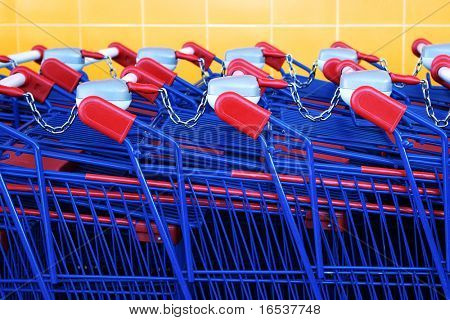 Detail of a row of supermarket karts tidy put together