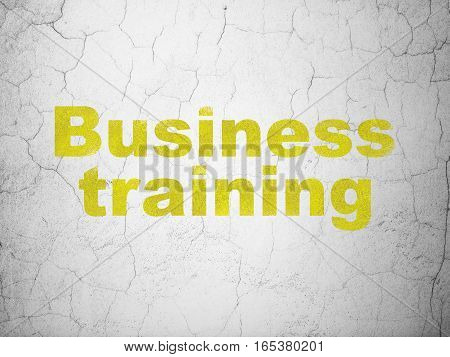 Education concept: Yellow Business Training on textured concrete wall background