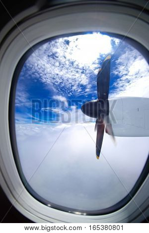 Airplane's air propeller view from window. Travel concept