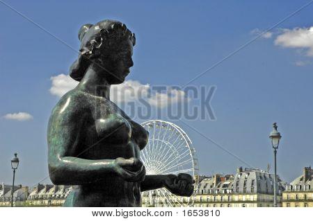 Sculpture With Ferris Wheel In Tuileries Garden