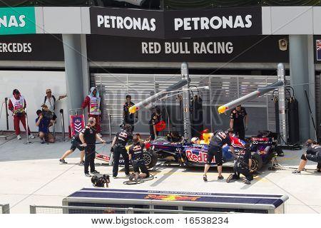 Sebastian Vettel doing a trial pit during Friday practice