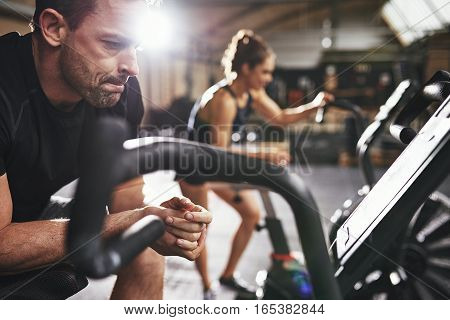 Male And Woman Taking Rest After Workout