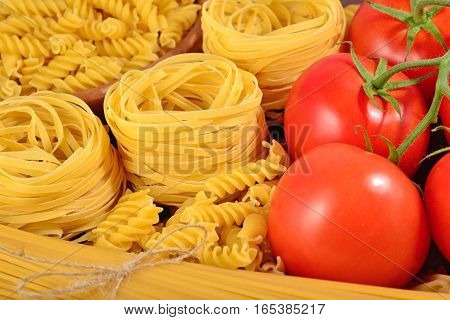 Uncooked Italian Pasta And Ripe Tomatoes Branch