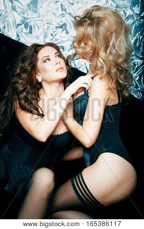 Two young sexy woman posing in lingerie