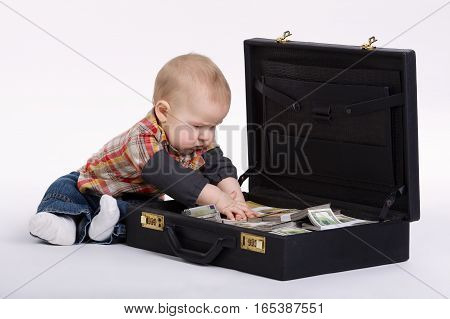 little young bookkeeper with suitcase of money