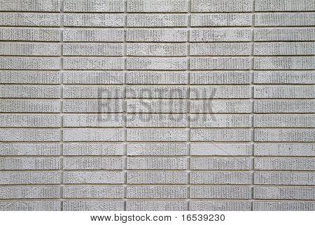 Large wall of white painted bricks taken up close