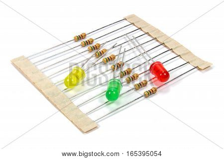 A set of resistors and colored LED diodes on a white background