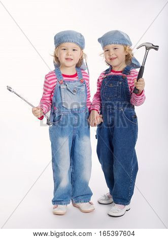 two cute twin girls are ready to work