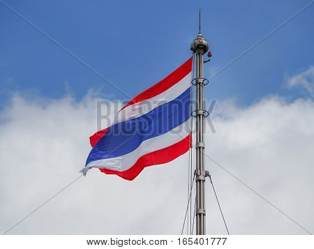 Thailand flag blows in the wind against a sky background