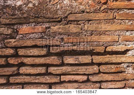 Ancient wall texture. Thin bricks and cement. Architecture of old world.