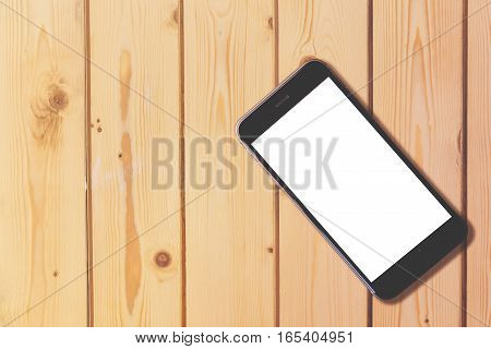 Smart phone with blank screen on wooden table background with copy space for moc up display your product