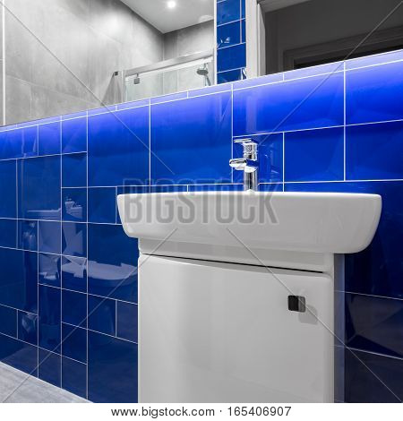 Bathroom With Blue Glossy Tiles