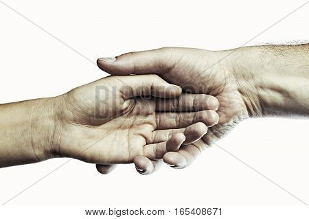 Male hand holds the female palm on toned background. That could mean help guardianship protection love care etc. This color image isolated for easy transfer in your design.