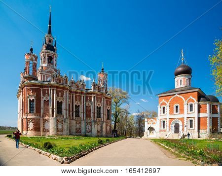 MOZHAYSK RUSSIA - APRIL 30 2016: The New Nikolsky Cathedral in Mozhaysk Kremlin Russia. A larger blood-red cathedral in the Gothic Revival style.