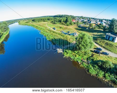 Aerial view of the fishermen in the river Mologa. Shooting with the bird's eye view of Maksatikhinskiy district of Tver region.
