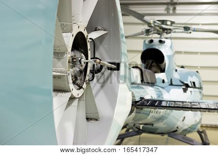 Luxury Private Helicopter Parked In The Hangar.