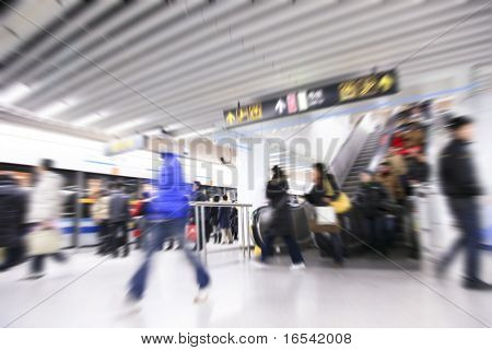 the people going on the subway station in shanghai china.