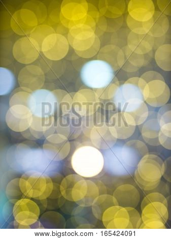 gold abstract background with bokeh defocused lights. Soft blurred yellow and gold bokeh background, Abstract lights. Defocusing lens