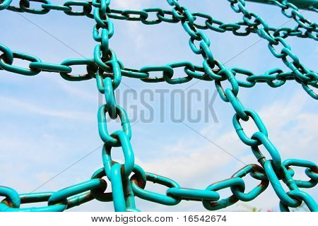 The iron chain of  fitness equipment with a blue sky background in a park .