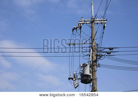 A telegraph pole with a spread of wires - landscape format.
