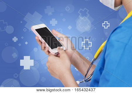 Female Nurse Using Pink Mobile Dark Screen Over Abstract Blue With Hospital Icon Background.
