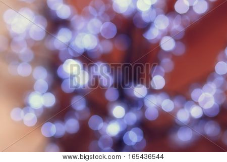 Soft color bokeh. White circles on backdrop. Blurred white circles. Soft focus background.