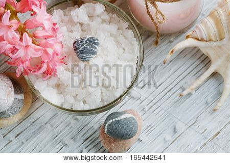 Composition of spa treatment with salt on wooden background