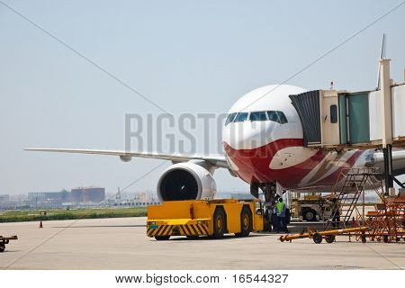 airplane is waiting for departure in pudong airport shanghai china.