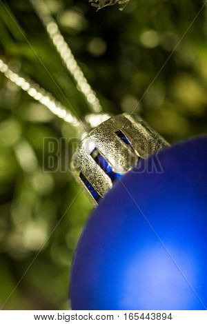 Christmas blue ball on the pinetree, blurred background, macro