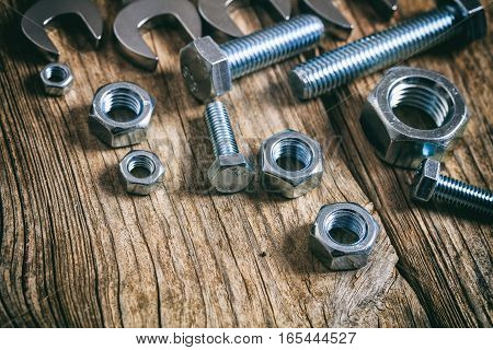Wrenches Bolts And Nuts On Wooden Background