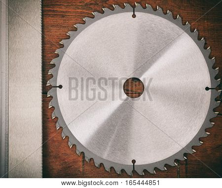 Saw Blade On Wooden Background