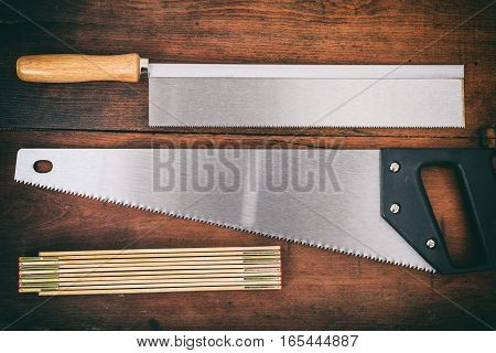Hand Saws On Wooden Background