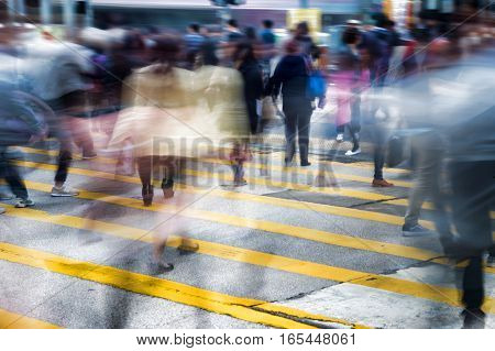Conceptual motion blur picture of people crossing the street in a big city