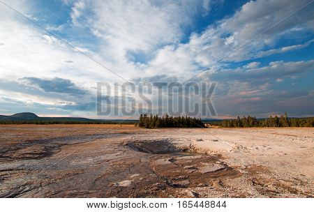 Opal Pool under afternoon cloudscape in the Midway Geyser Basin in Yellowstone National Park in Wyoming USA